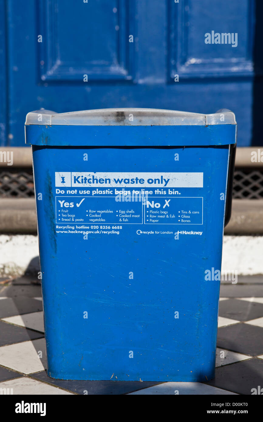 Kitchen waste recycling. Hackney council provide households with blue bins for food scraps. London, UK. Stock Photo