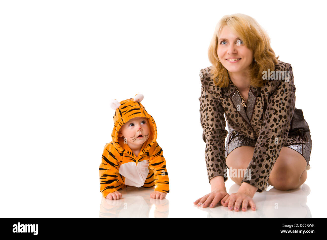 Mother with half year daughter baby wearing tiger costume isolated - Stock Image