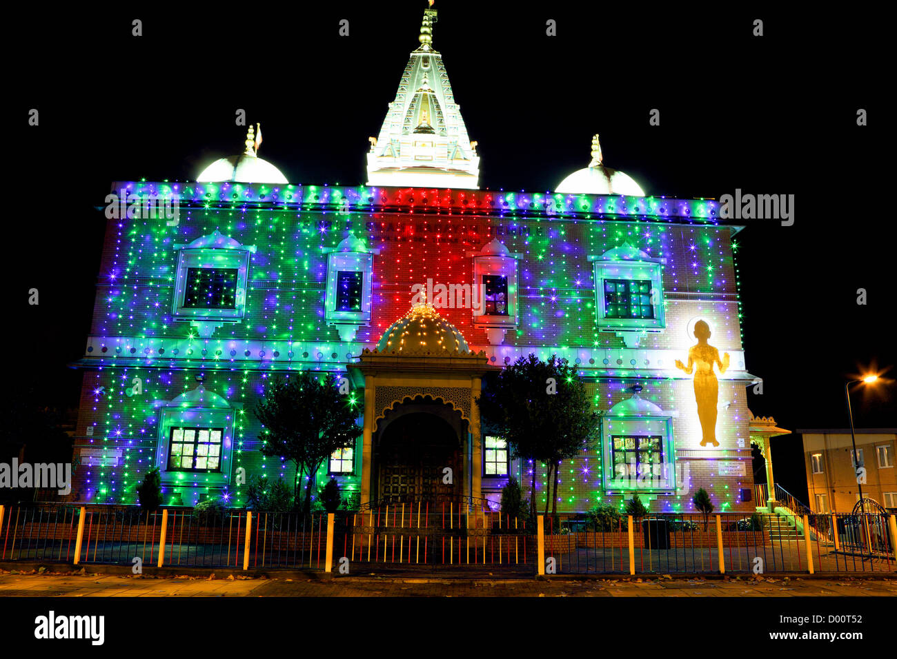 The Shree Swaminarayan Temple, seen here festooned with bright coloured lights celebrating Dawali. - Stock Image