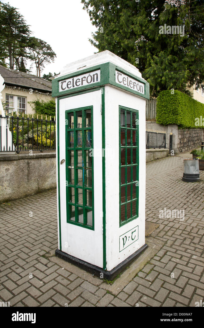 irish white and green phone box at the street - Stock Image