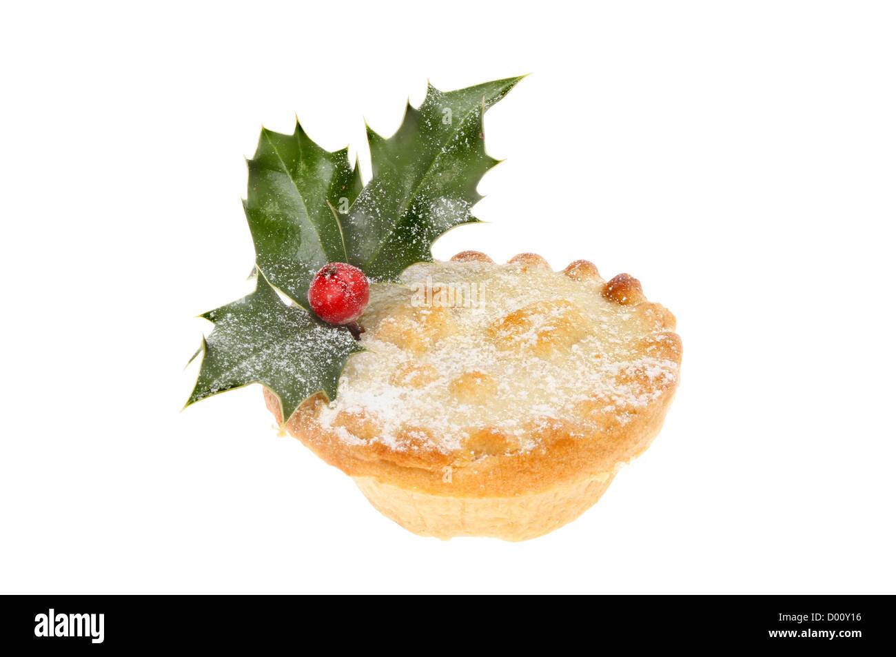 Mince pie dusted with icing sugar and decorated with a sprig of real holly isolated against white - Stock Image