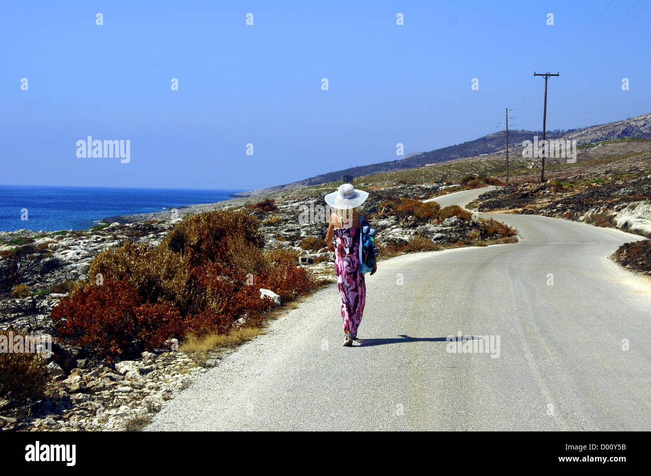 girl walking on seaboard, Zakynthos island, Greece - Stock Image