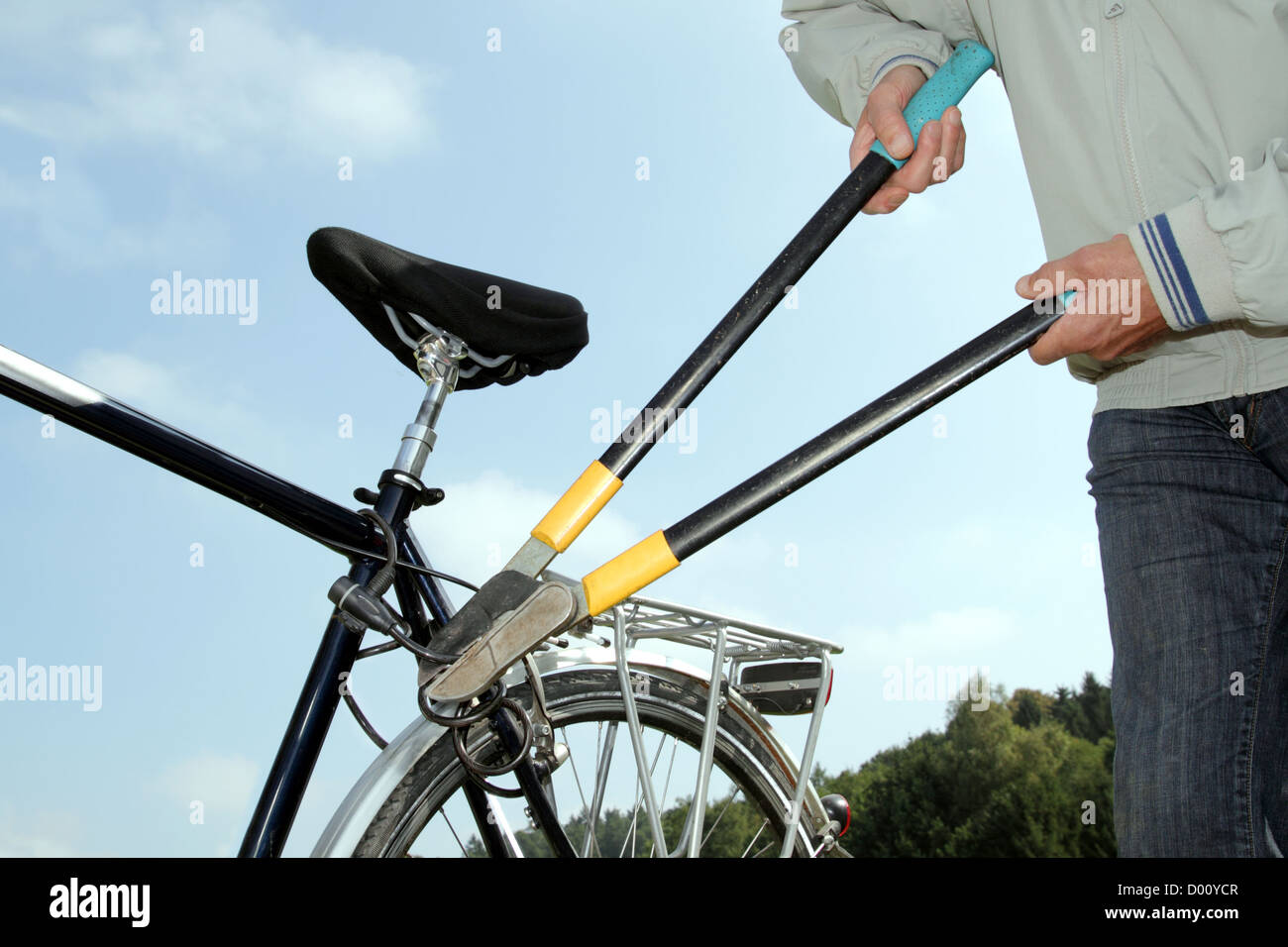 Thief stealing a Bycicle - Stock Image