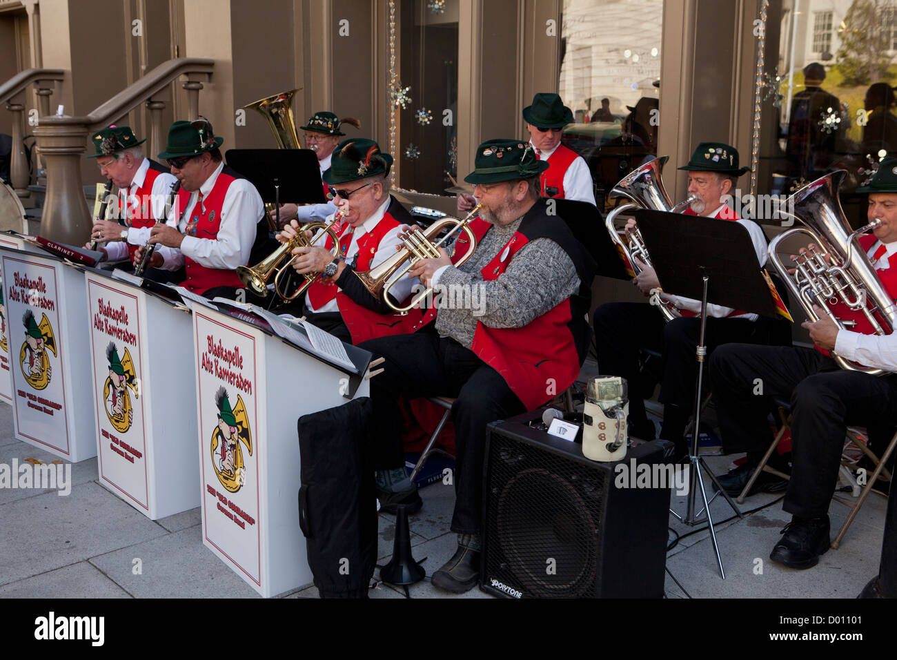 Traditional German music band performing outdoors - Stock Image