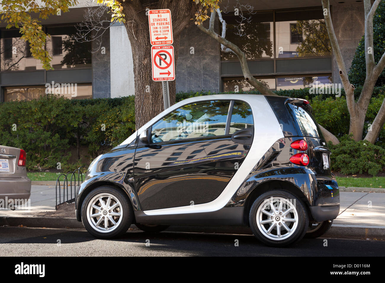Illegally parked SmartCar - Stock Image