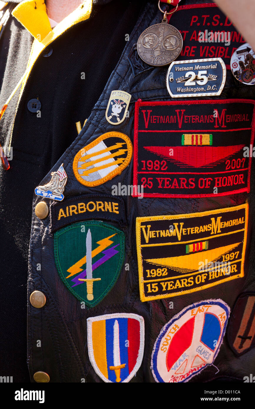 Vietnam veteran's jacket adorned with unit patches and memorabilia - Stock Image