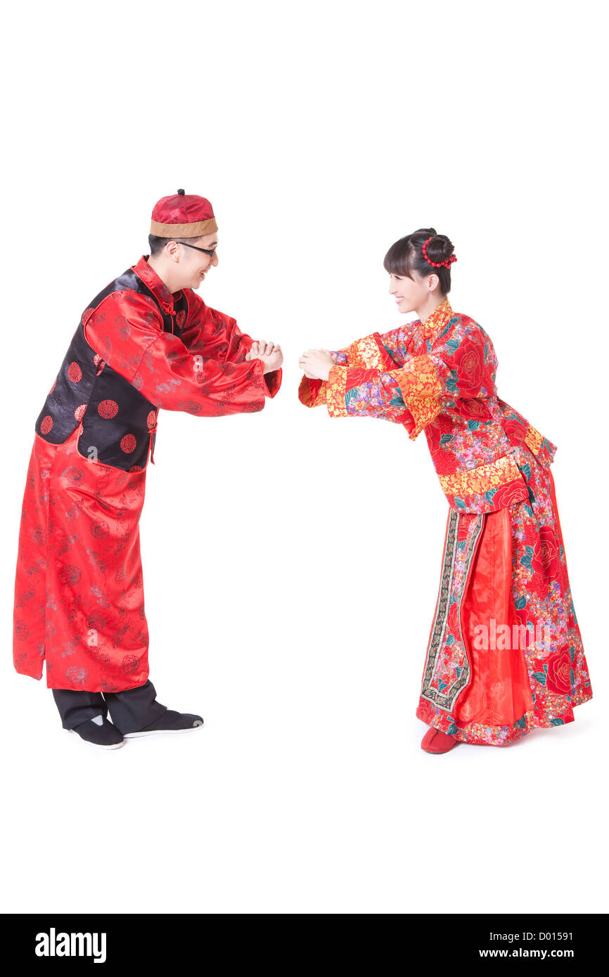 Young couple greeting for chinese new year in traditional chinese young couple greeting for chinese new year in traditional chinese clothing m4hsunfo