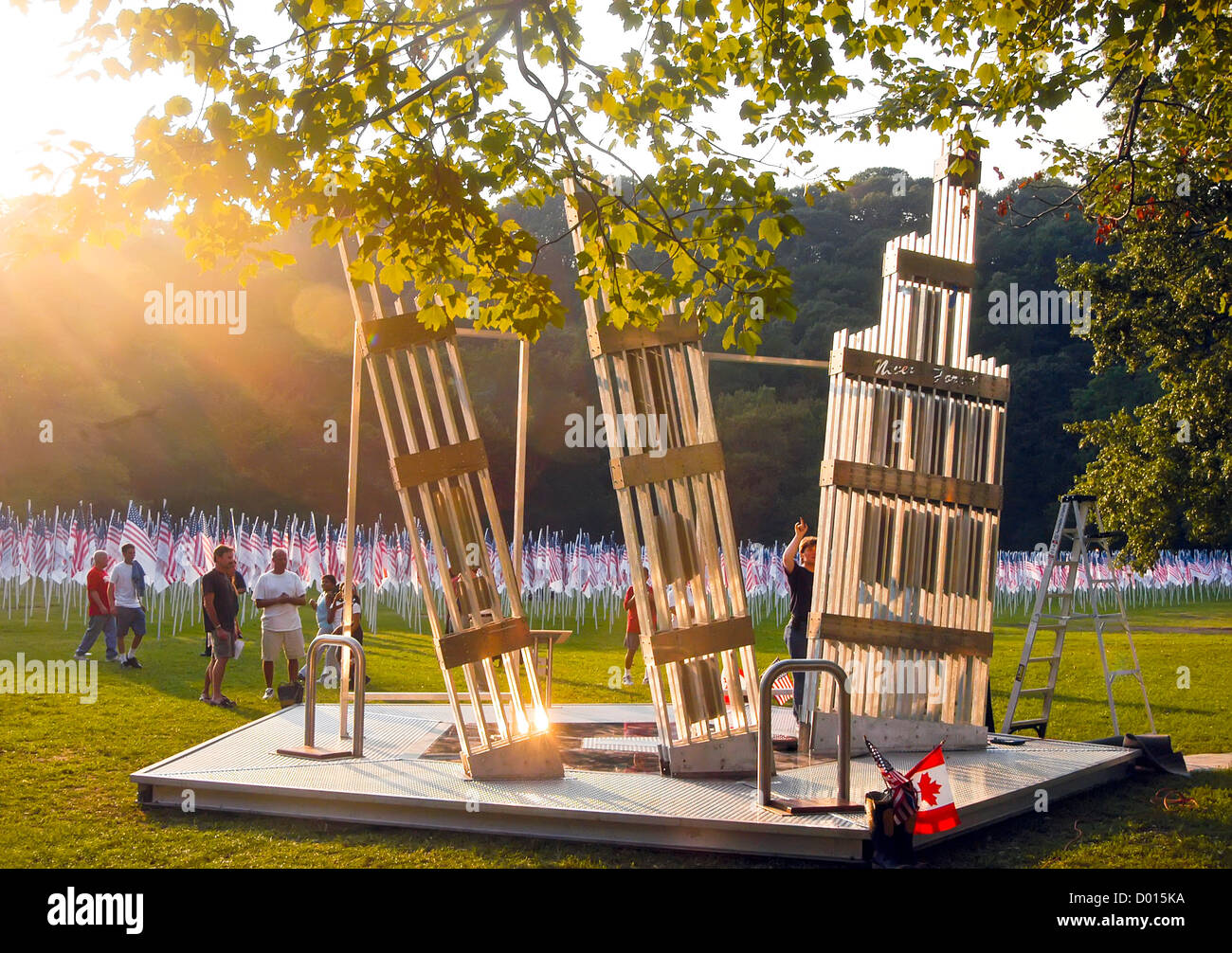 'Release of Souls' a 911 memorial sculpture surrounded by  '3000 Flags of Heroes' in memory of those - Stock Image