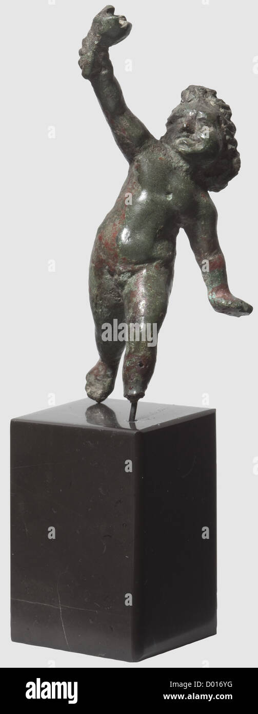A Roman amor with torch, 1st - 2nd century AD. Bronze with greenish and brownish patina. Fully sculptured figure - Stock Image