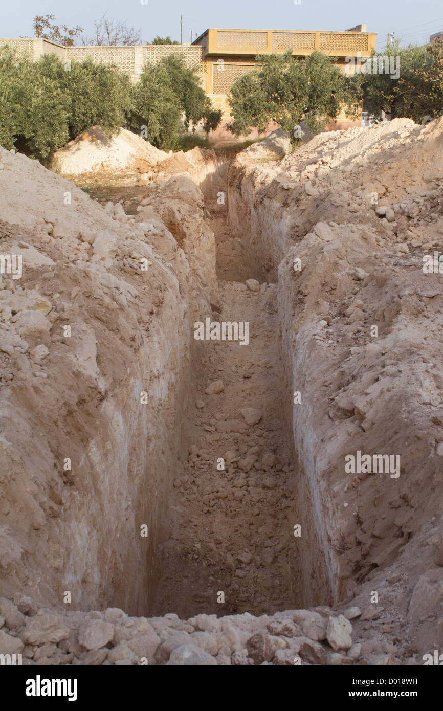 trench dug near the frontline in Azeze. The Free Syrian Army plans to use it in case of attack. - Stock Image