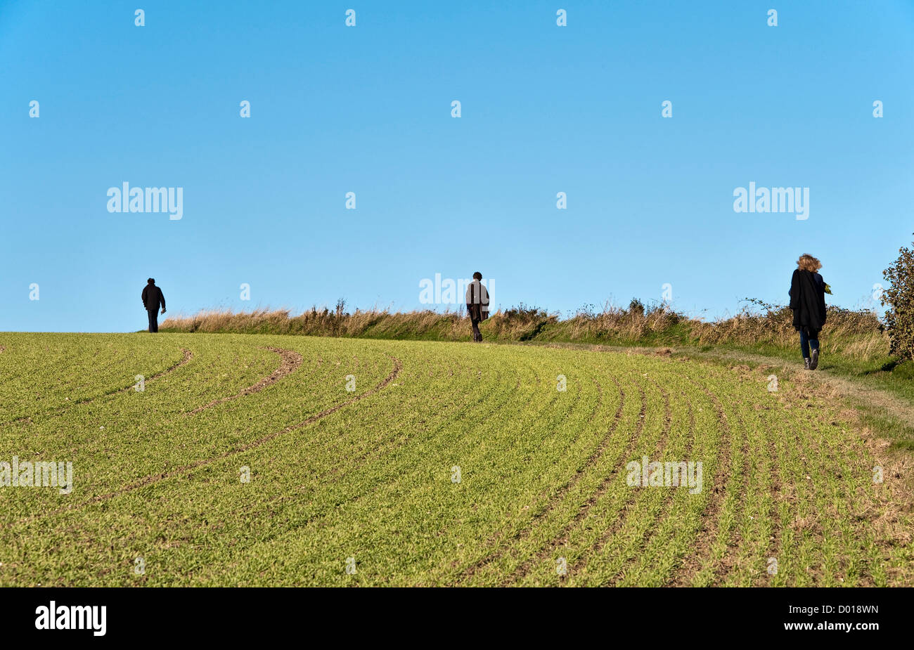 Three people on a walk in the country - Stock Image