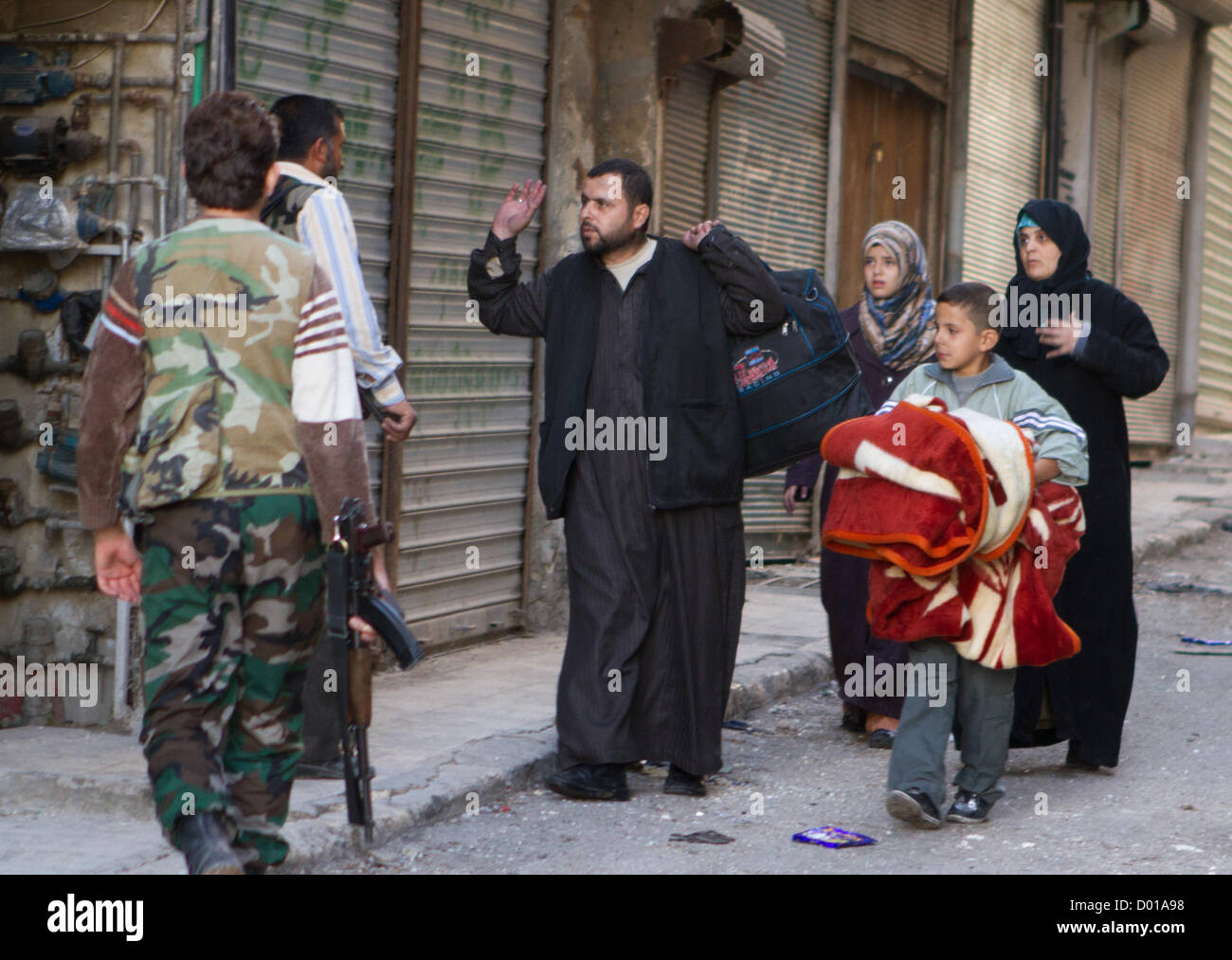 Aleppo, Syria: People returned home during the Eid Al Adha holiday to gather their possessions near the frontline - Stock Image