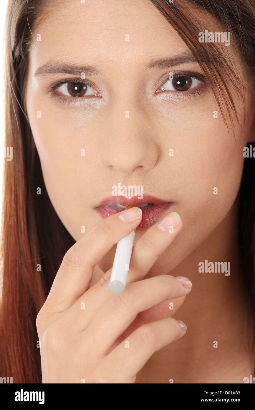 Young woman smoking electronic cigarette (ecigarette), isolated on white - Stock Image