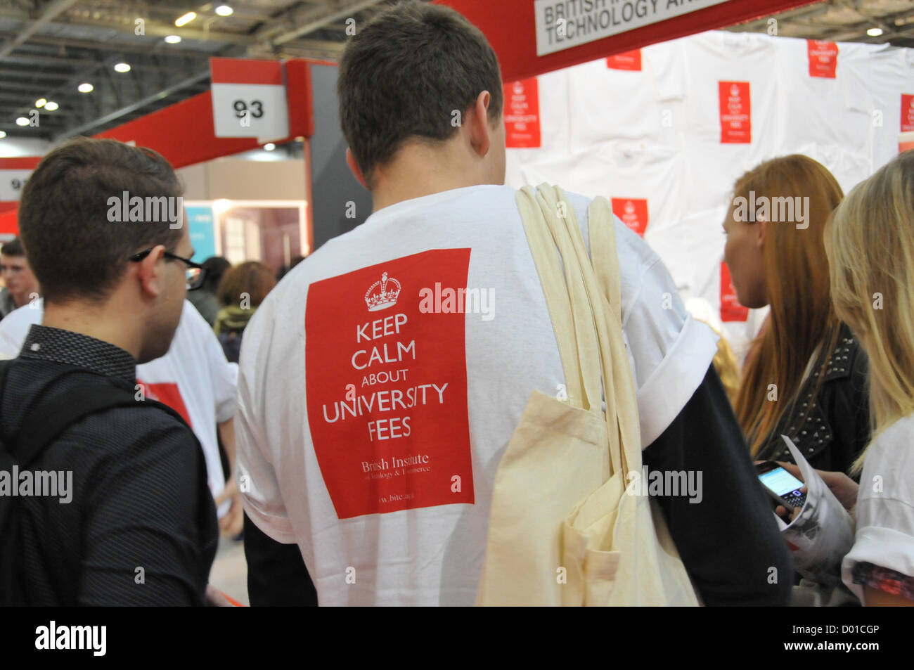 Excel, London, UK. 14th November 2012. A man wears a T Shirt with the slogan 'Keep Calm about University Fees'. - Stock Image