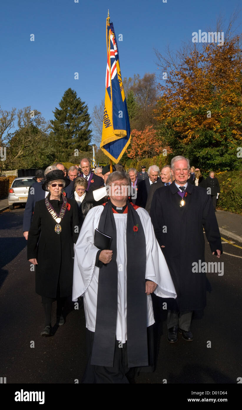 Local Rector leading procession to high street from church on Remembrance Sunday, Haslemere, Surrey, UK. 11.11.2012. - Stock Image