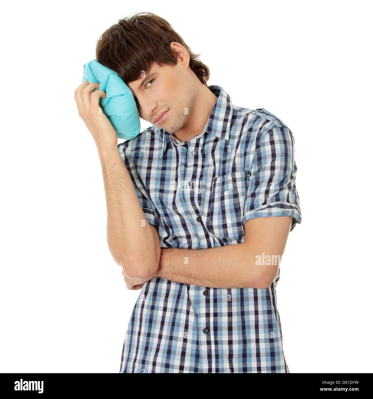 Man with ice bag for headaches, migraines ,hangover and injury - Stock Image