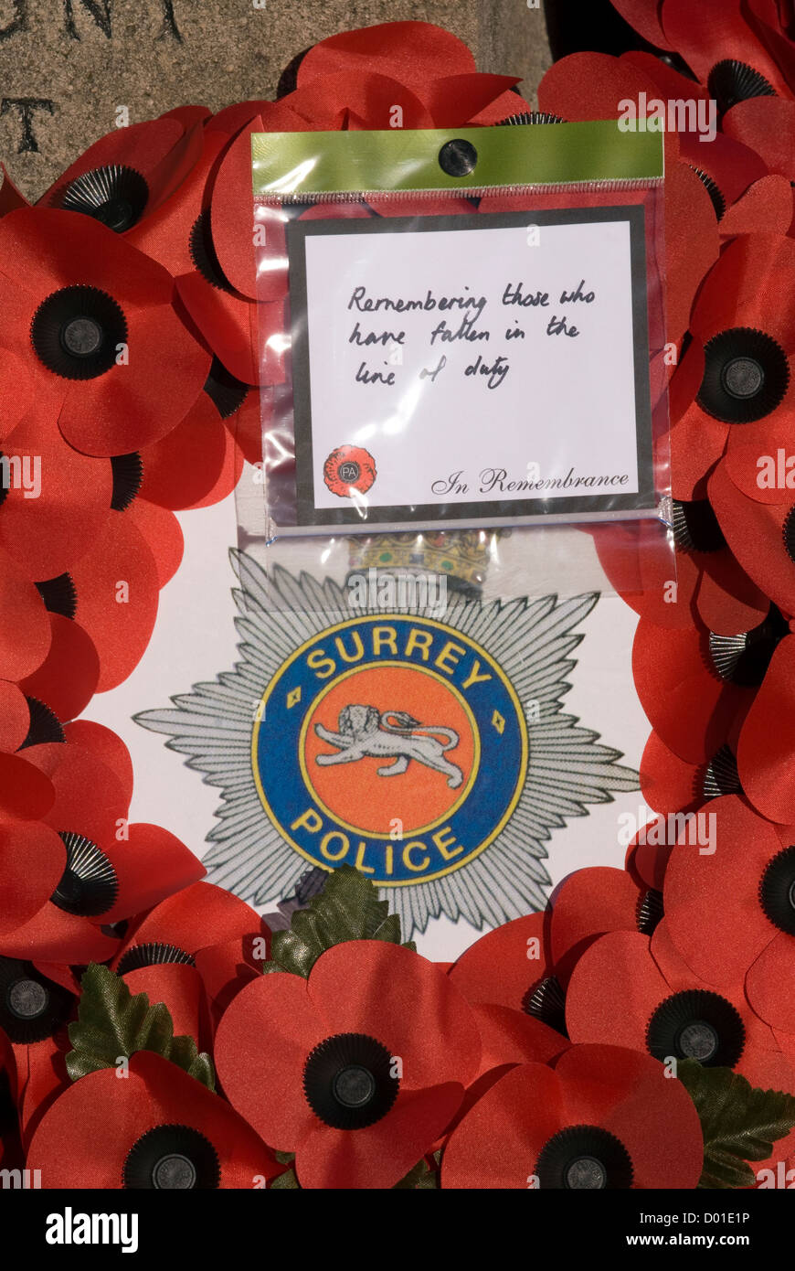 Wreath left by Surrey Police at local war memorial on Remembrance Sunday, High Street, Haslemere, Surrey, UK. 11.11.2012. - Stock Image