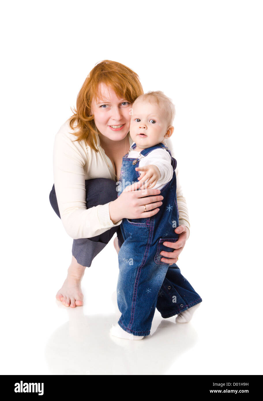 Mother with son looking interested at you isolated on white - Stock Image