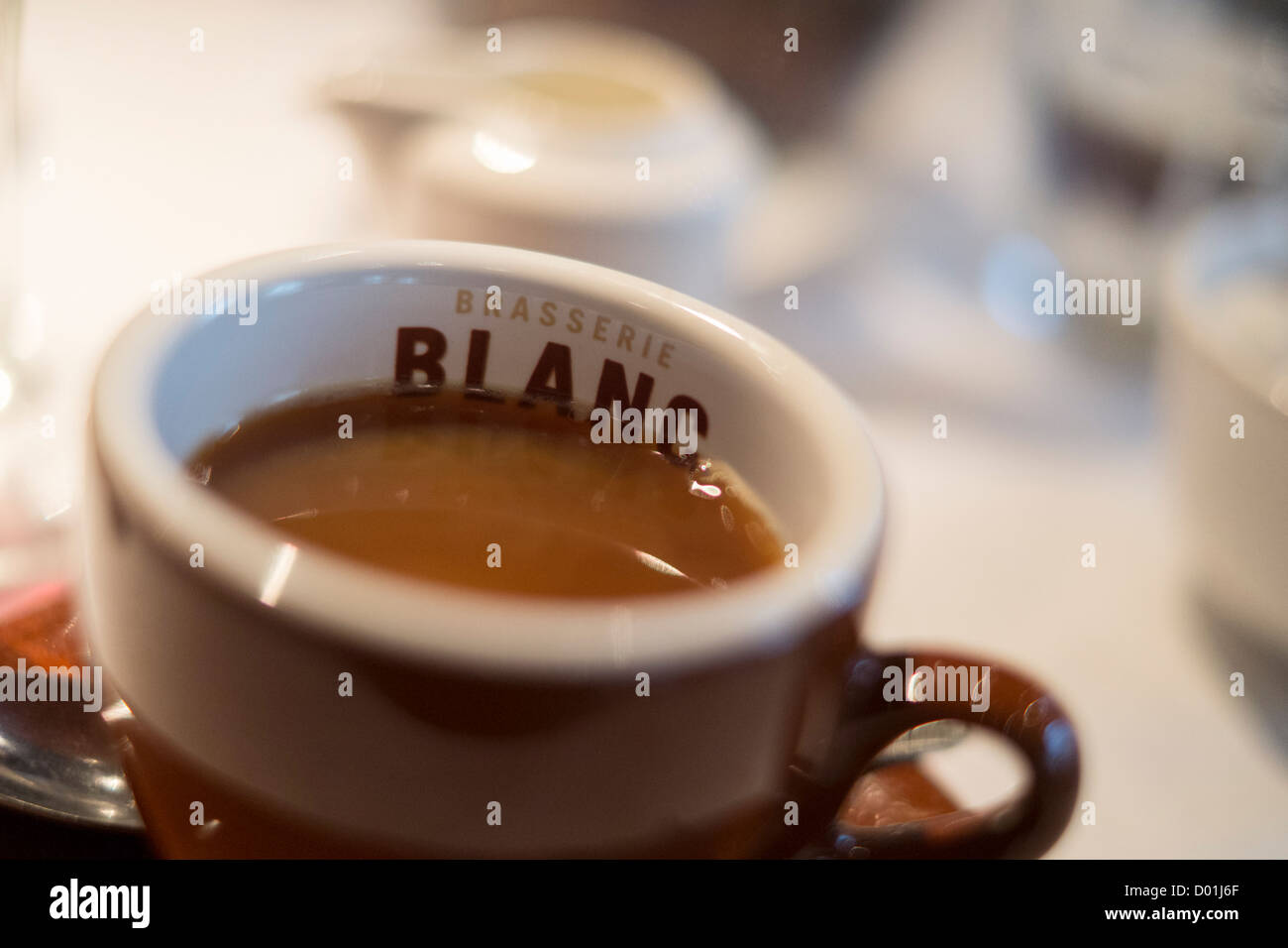 A cup of coffee in the Brasserie Blanc restaurant in Cheltenham, Gloucestershire, UK. - Stock Image