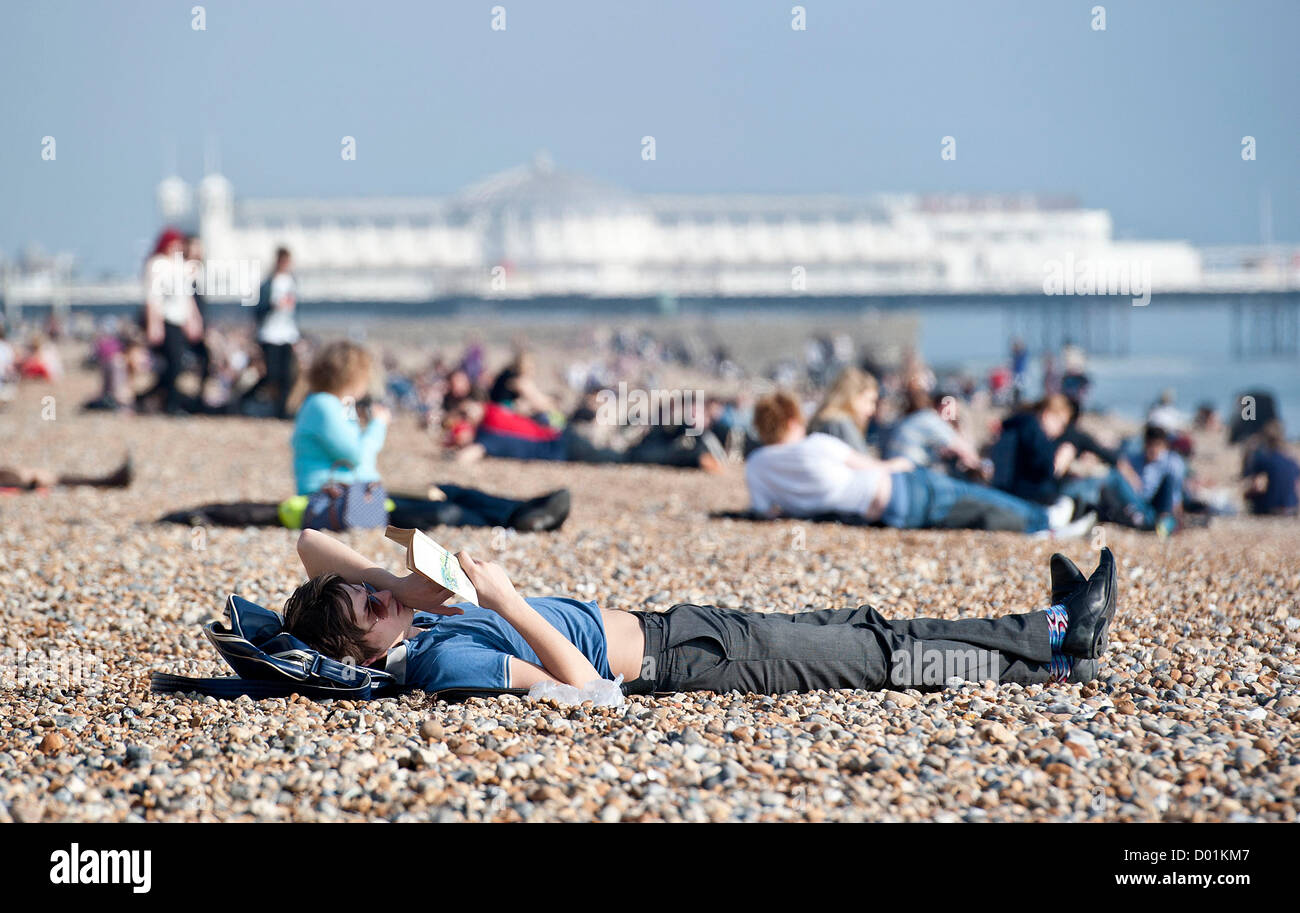 Hot weather hits the UK today with temperatures reaching unusually high for this time of year. Members of the public - Stock Image
