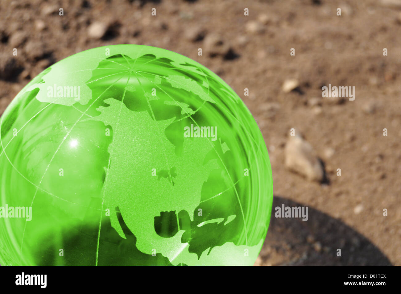 climate change concept with earth planet on dry soil and copyspace - Stock Image