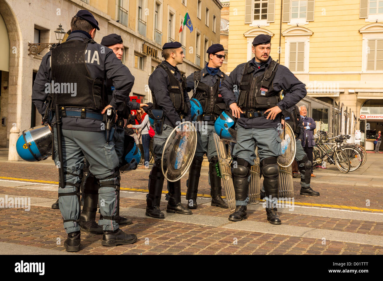 Italian police watching a political demonstration against Italian austerity masseurs, Parma, Italy - Stock Image