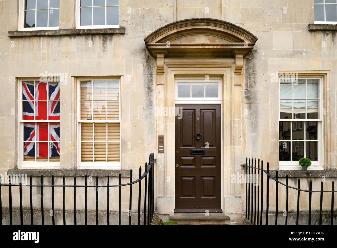 A patriotic british house with a Union Jack flag in the window, Bath Somerset UK - Stock Image