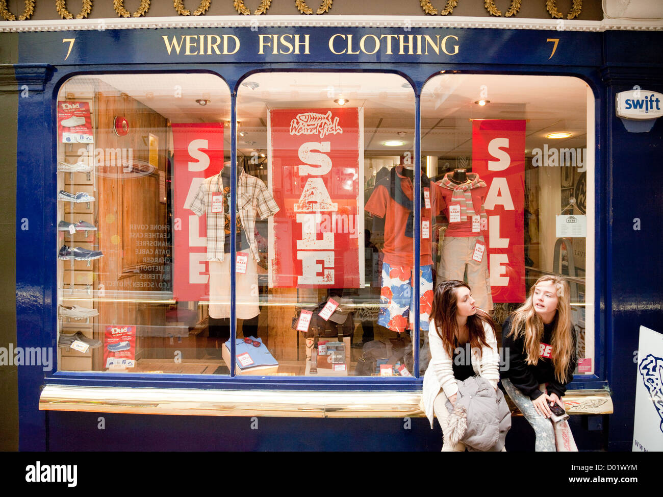 Two teenage girls outside the Weird Fish clothing store shop, Bath ...
