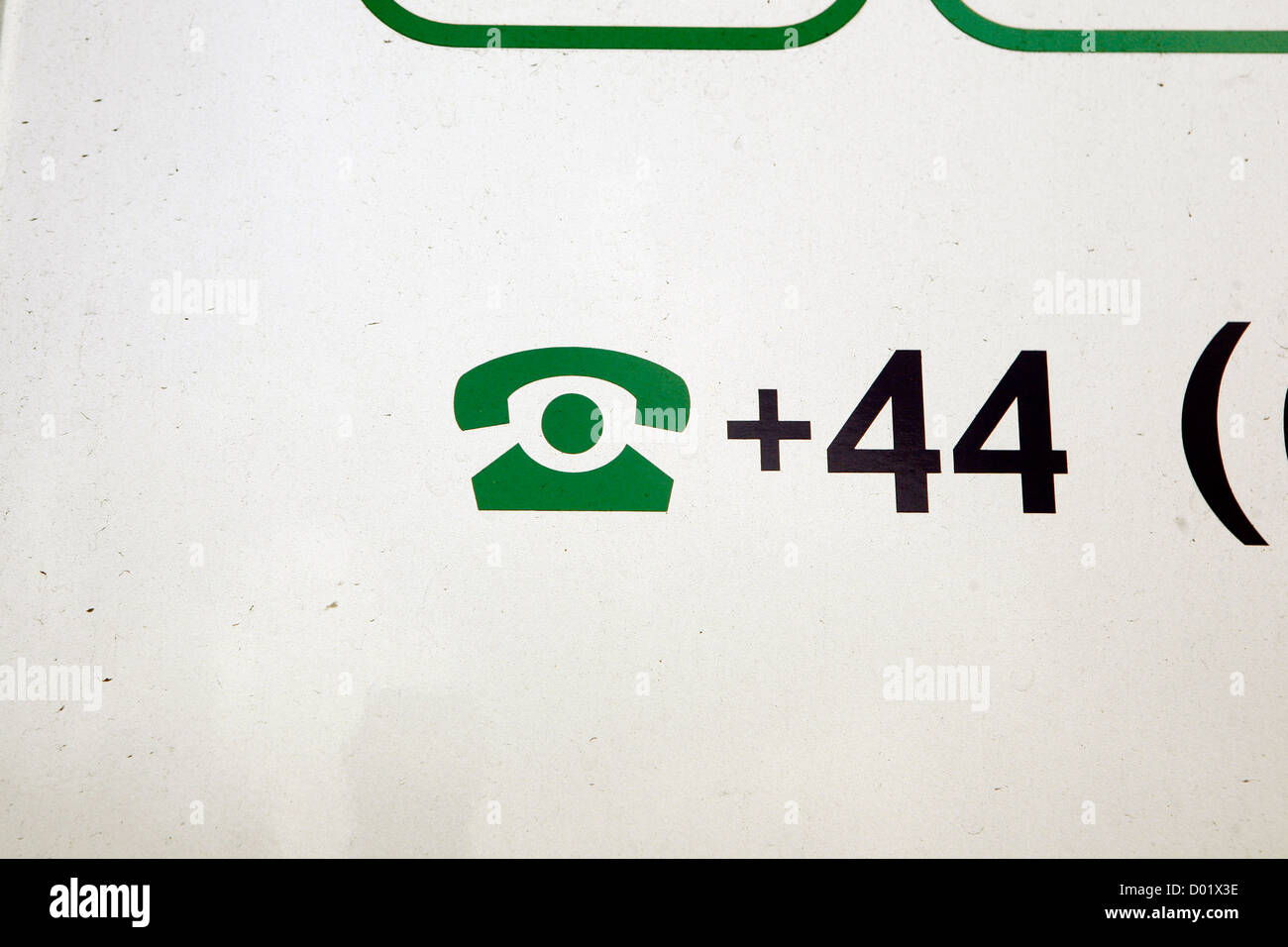 A symbol of a telephone and the +44 UK national phone code Stock
