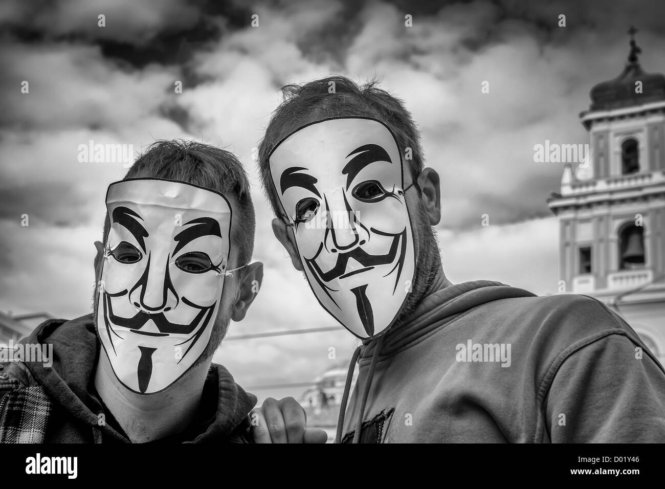 Italian demonstrates wear Guy Fawkes during a demonstration against austerity masseurs in Parma, Italy - Stock Image