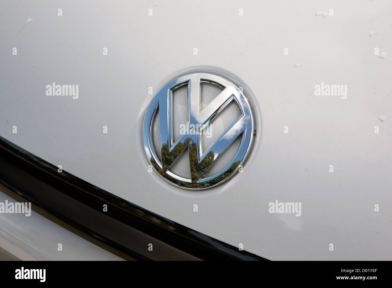 A silver Volkswagen badge as seen on the bonnet of a VW. - Stock Image
