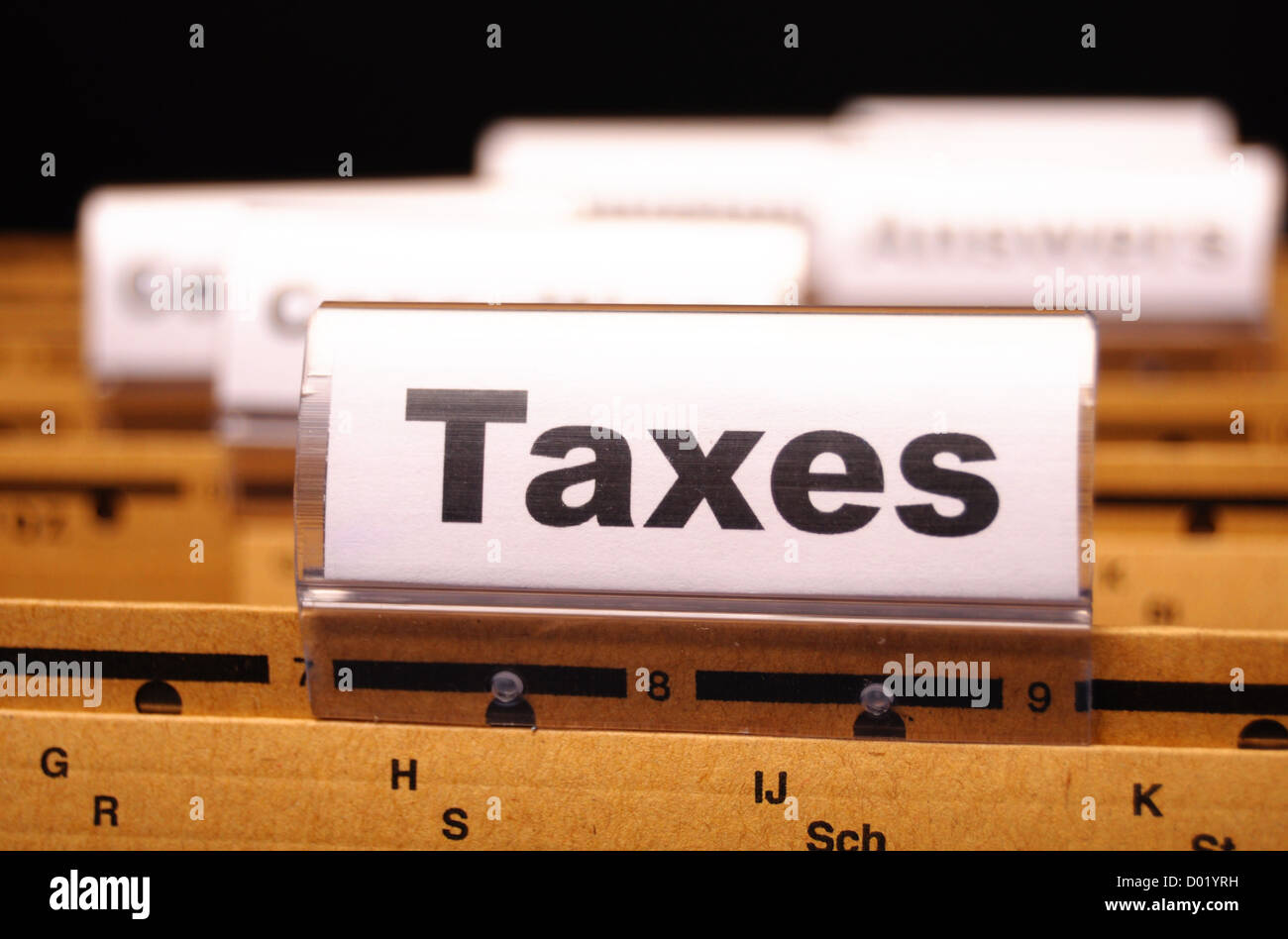 tax or taxes concept with word on business folder index - Stock Image