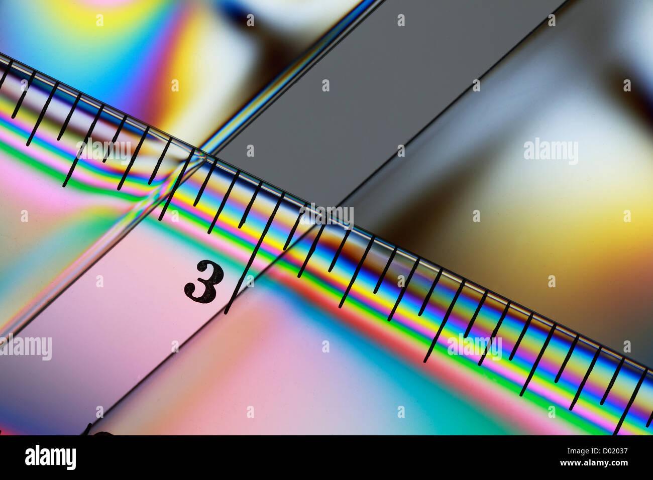 Cross Polarisation plastic ruler - Stock Image