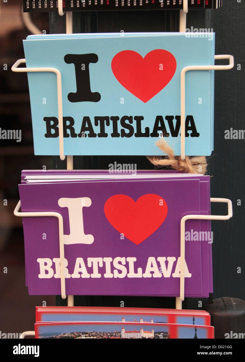 'I love Bratislava' postcards on sale outside a tourist shop in Bratislava, Slovakia. - Stock Image