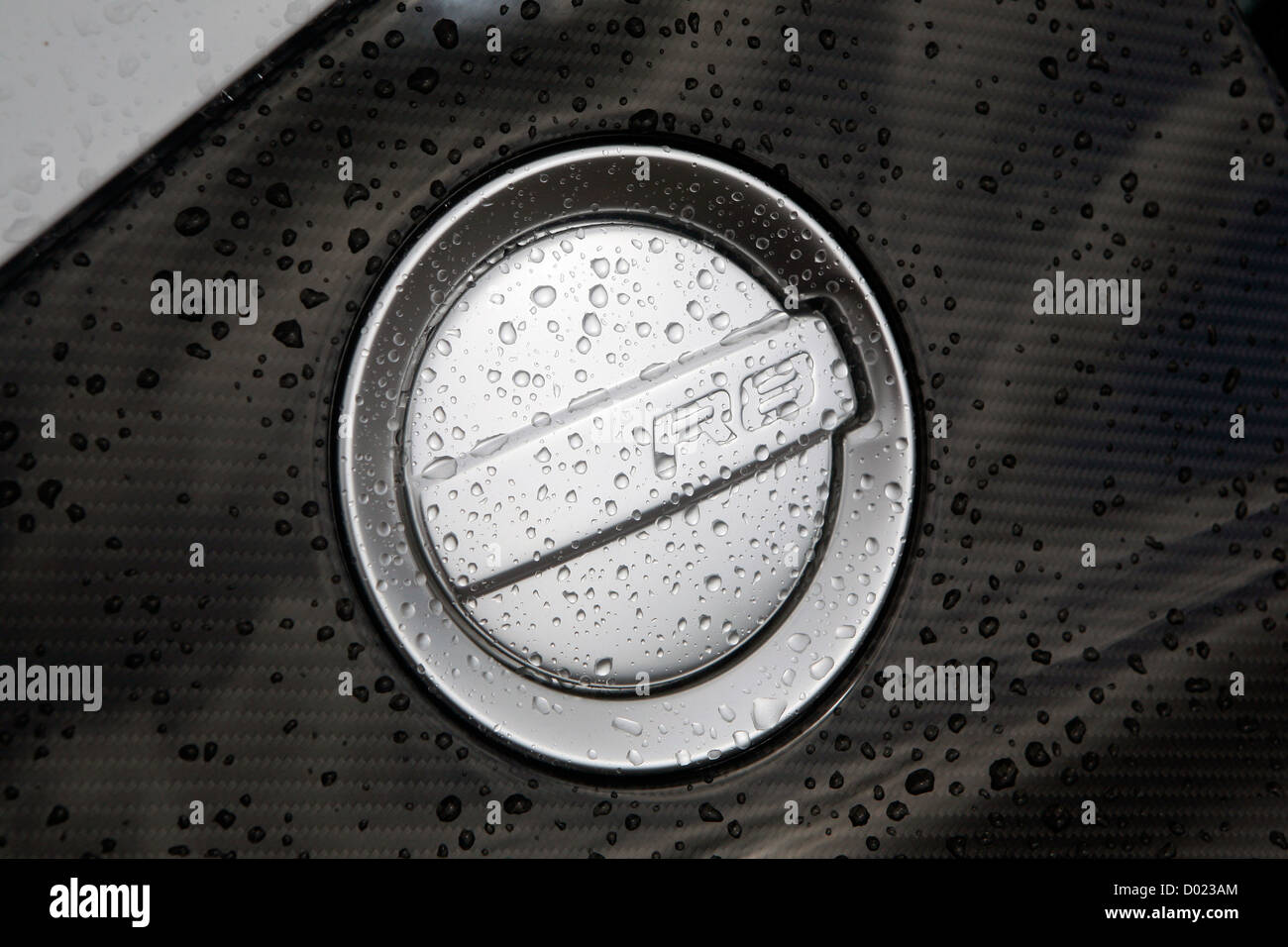 A rain spotted fuel cap on an Audi R8. Stock Photo