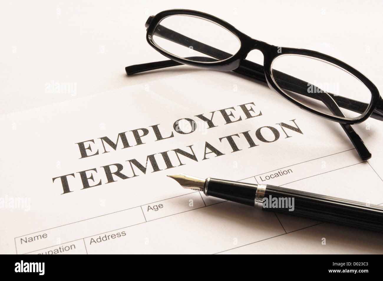employee termination form on desk in business office showing job concept - Stock Image