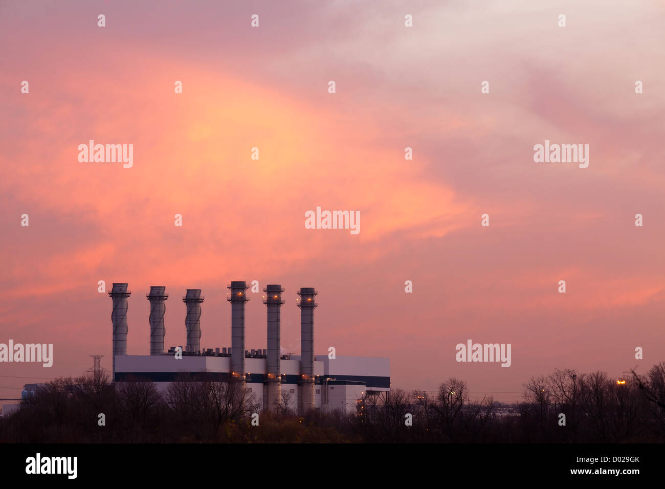 Industrial building at sunset - Stock Image
