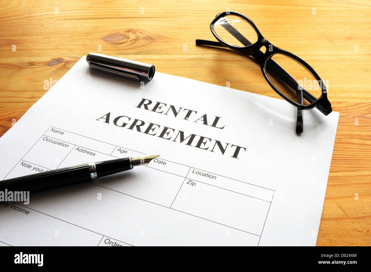 rental agreement form on desktop in business office showing real estate concept Stock Photo