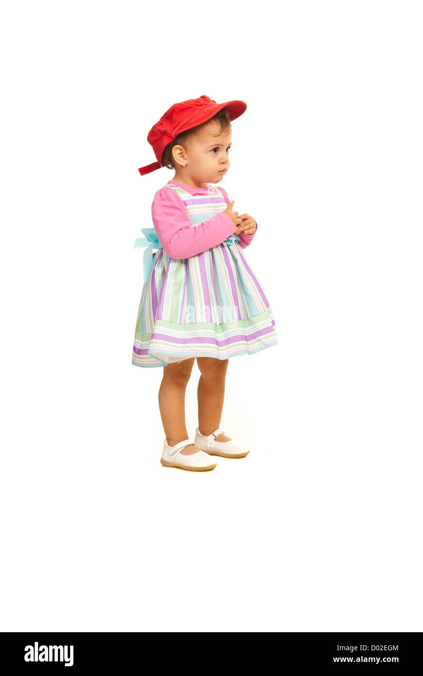 c2f42ca9 Full length of beauty toddler girl looking away isolated on white  background - Stock Image