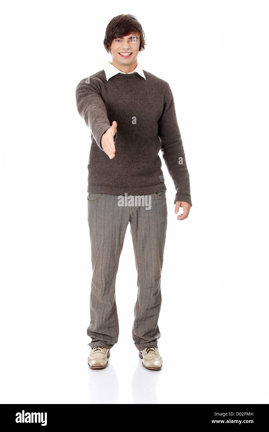 Young man's shaking hand. Isolated on white background. - Stock Image
