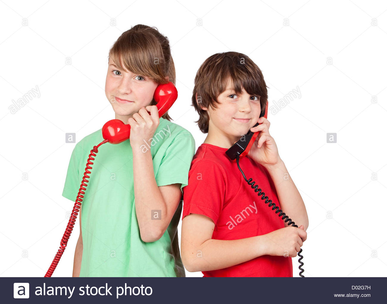 Two brothers with red telephone isolated on white background - Stock Image