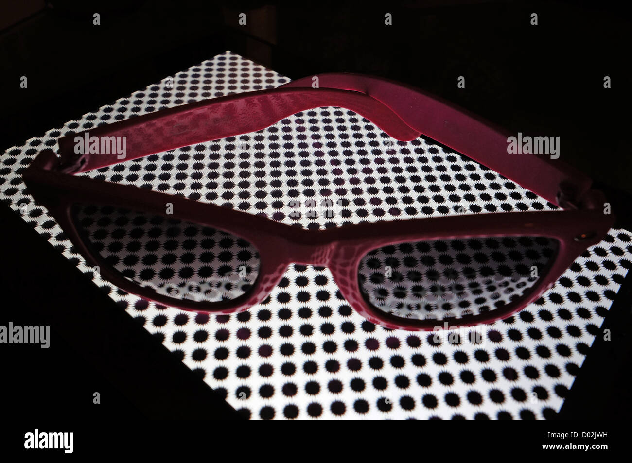 Sunglasses on chequered surface - Stock Image