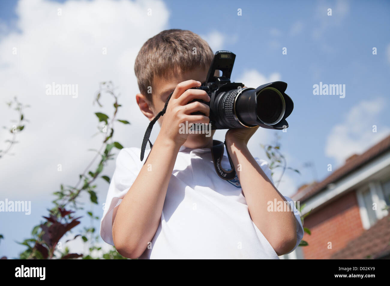 Young photographer taking photographs - Stock Image