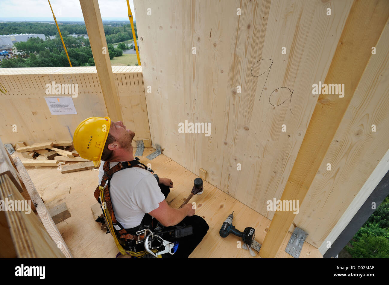 GERMANY Hannover, Timbertower GmbH, construction of 100 metre high tower made from timber for 1,5 MW Vensys wind Stock Photo