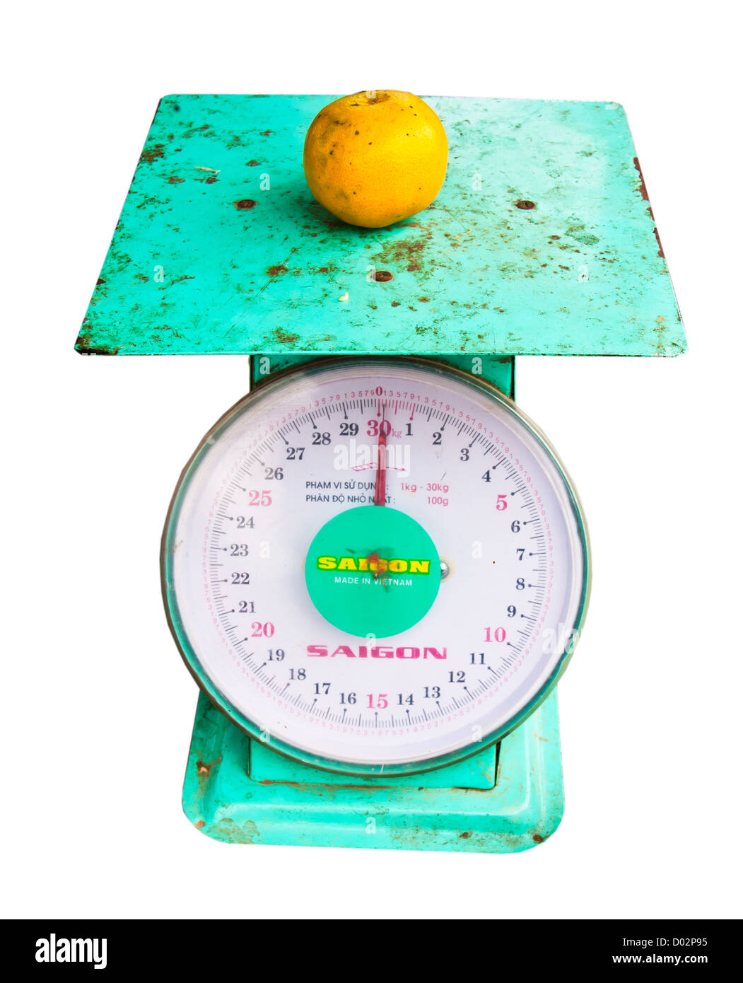 weighing machine, and citrus fruits were placed on top. - Stock Image
