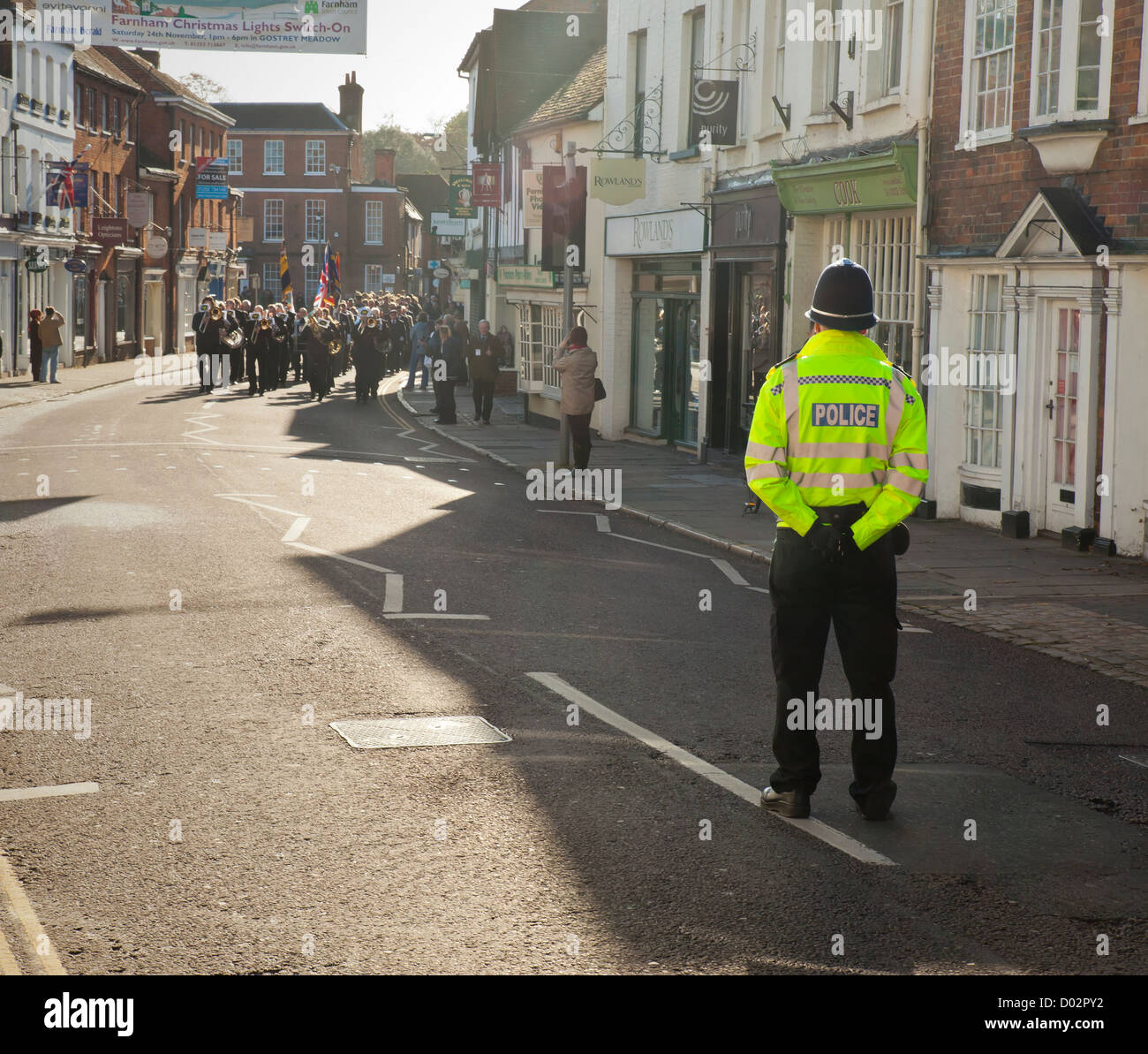 Policing a remembrance day Parade, Farnham. - Stock Image
