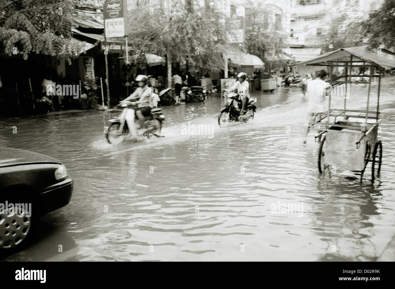 Monsoon rain storm weather climate in Phnom Penh Cambodia in Far East Southeast Asia. Stormy Rainstorm Reportage - Stock Image