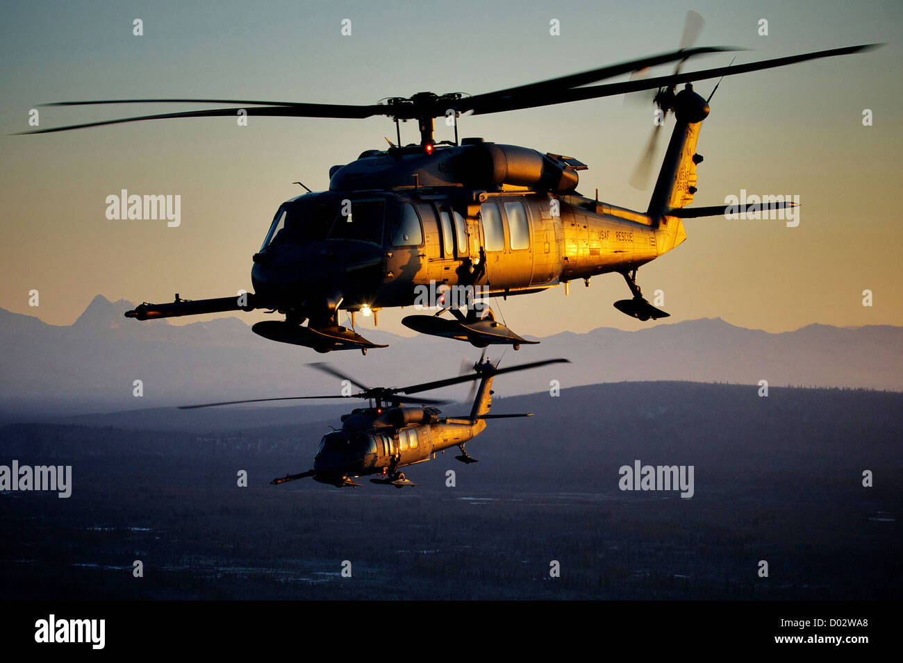 The US Air Force HH-60 Pave Hawk flies at sunset January 19, 2012. - Stock Image