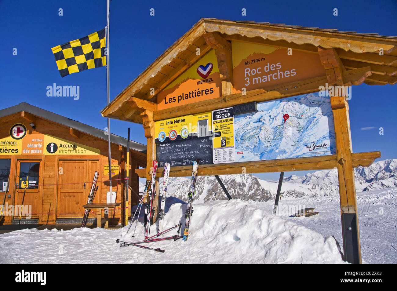 Information map and security cabin at the top of the ski lift snowy