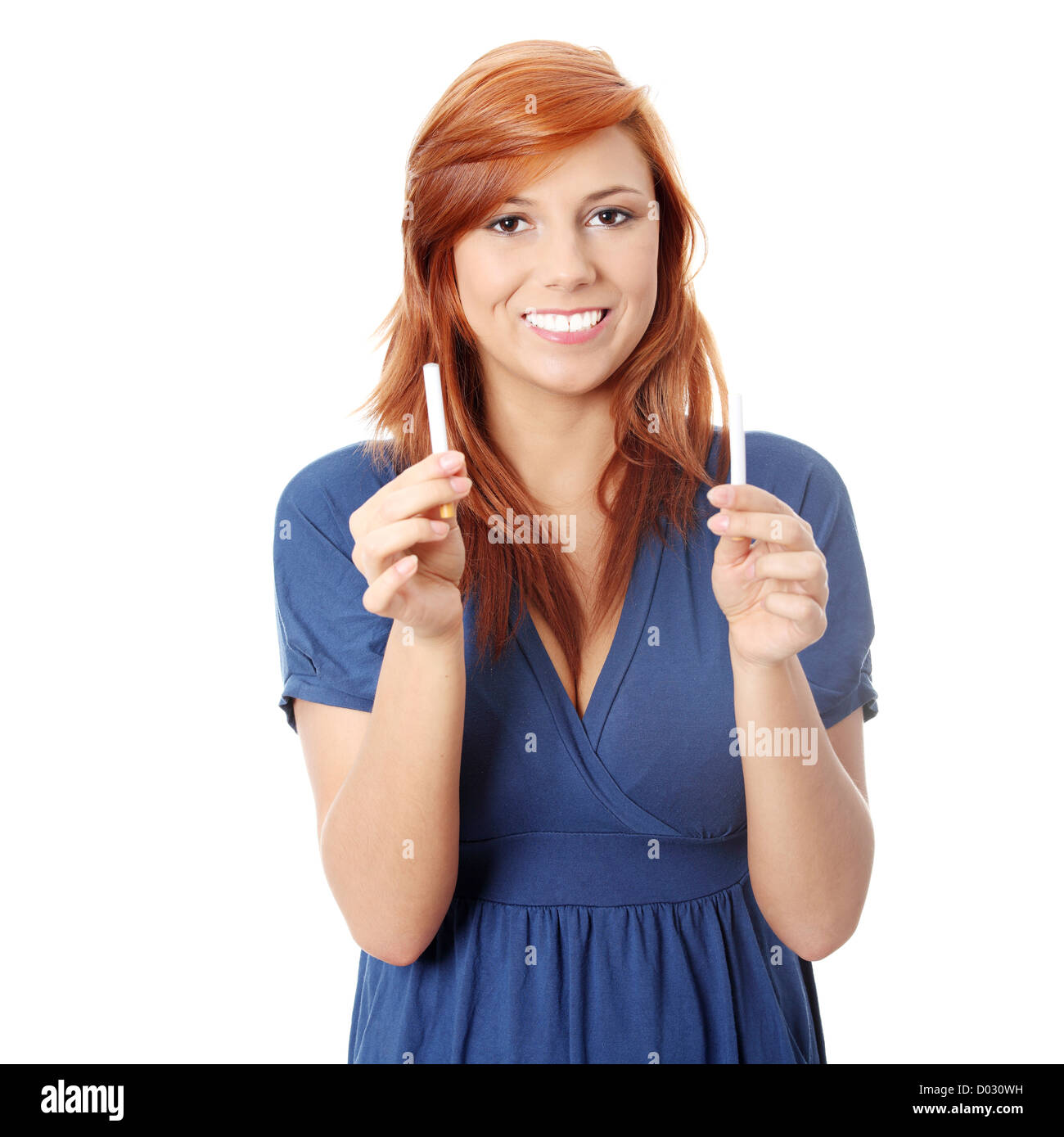 Young woman holding cigarette and electronic cigarette, isolated on white - Stock Image